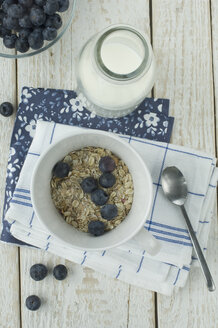 Bowl of granola and blueberries - ASF005588