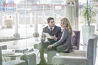 Two business people in a hotel lobby - ZEF005861