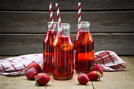 Three glass bottles of homemade strawberry lemonade - LVF003362