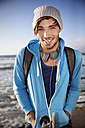 Portrait of smiling young man at the coast - TOYF000444