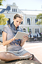 Young woman using digital tablet outdoors - TOYF000527