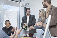 Business colleagues celebrating success - ZEF005761