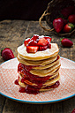 Stack of pancakes with strawberry sauce and strawberries - LVF003370