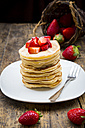 Stack of pancakes with strawberry sauce and strawberries - LVF003375