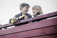 Two little boys having fun on a playground - MJF001520