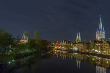 Germany, Luebeck, cityscape at night - NKF000243
