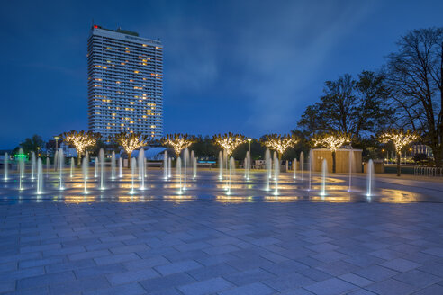 Germany, Travemuende, fountain and illuminated trees in front of the Maritim Hotel - NKF000248