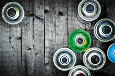 Aerosol cans on wood - KSWF001526