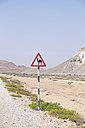 Oman, Ras al-Jinz, camel warning sign - HLF000892