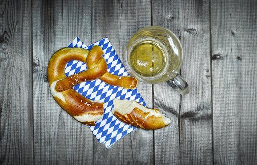 Bavarian pretzel on napkin and glass of beer - KSWF001535