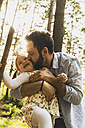 Happy girl with father in forest - UUF004285