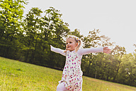 Carefree girl running on meadow - UUF004314