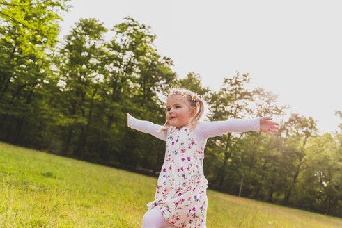 Carefree girl running on meadow - UUF004314