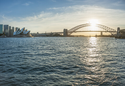 Australia, New South Wales, Sydney, Skyline with Sydney Harbour Bridge and Sydney Opera House at sunset - JBF000246
