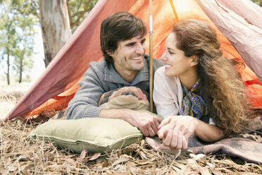 South Africa, happy couple lying in tent - TOYF000674