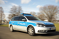 Germany, Cologne, Police car in motion - TOY000714