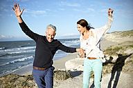 South Africa, couple balancing on walk along the coast - TOYF000759