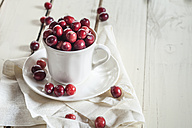 Fresh cranberries in a coffee cup - SBDF001885