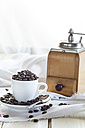 Old coffee mill and coffee cup filled with coffee beans - SBDF001905