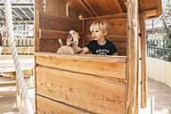 Little boy steering wooden ship on playground - MFF001625