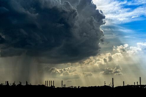Germany, Bavaria, Burghausen, dark clouds over industrial area - HAMF000042