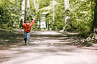 Germany, Bielefeld, boy running on forest path - MMFF000779