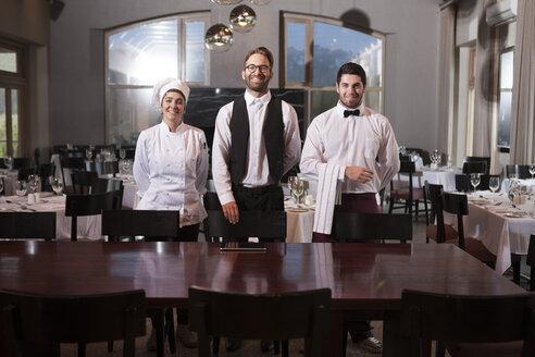 Restaurant employees receiving guests - ZEF005129