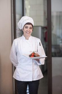 Chef serving main dish - ZEF005148