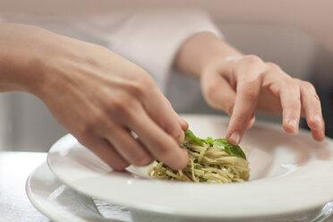 Chef garnishing plate with food - ZEF005174
