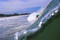 Indonesia, Bali, Surfer in the tube getting barreled - KNTF000036