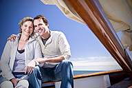 Happy mature couple on a sailing ship - TOYF000818