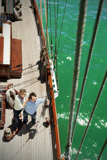 Mature couple on deck of a sailing ship - TOYF001036
