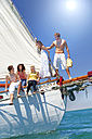 Happy friends on bow of a sailing ship - TOYF000852