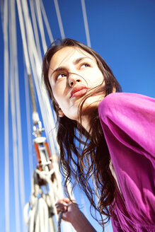 Brunette young woman on a sailing ship - TOYF000925