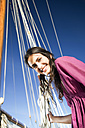 Smiling brunette young woman on a sailing ship - TOYF000927
