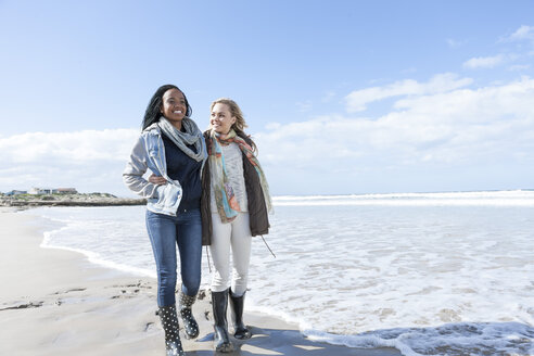 South Africa, Cape Town, two friends walking on the beach - ZEF005269