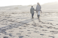 South Africa, Cape Town, mother and her son walking on the beach - ZEF005249