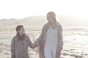 South Africa, Cape Town, mother and her son walking on the beach - ZEF005250