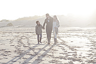 South Africa, Cape Town, young couple and son walking on the beach - ZEF005252