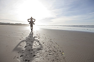 South Africa, Witsand, father carrying his son on shoulders while walking on the beach - ZEF005295