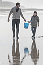South Africa, Witsand, father and son carrying bucket along the beach - ZEF005308