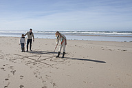 South Africa, Witsand, family playing tic tac toe on the beach - ZEF005319