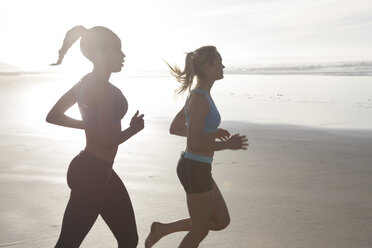 South Africa, Cape Town, two women jogging on the beach - ZEF005213