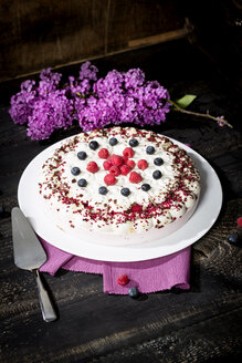 Raspberry-cream cake garnished with blueberries and raspberries - MAEF010597