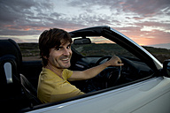 South Africa, portrait of smiling man in a convertible - TOYF000953