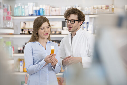 Pharmacist advising female customer - FKF001067