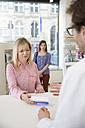 Pharmacist advising female customer - FKF001097