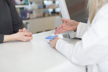 Female pharmacist advising female customer - FKF001114