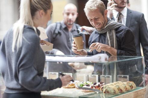 Man buying food at city market - ZEF007050