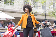 Portrait of young woman on shopping tour - ZEF006596